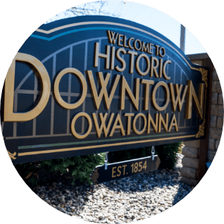 Sign saying 'Welcome to Historic Downtown Owatonna'